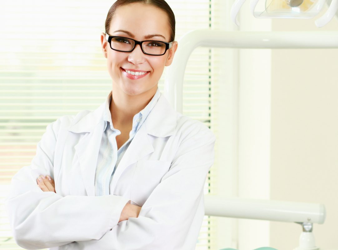 woman dentist at her office smiling